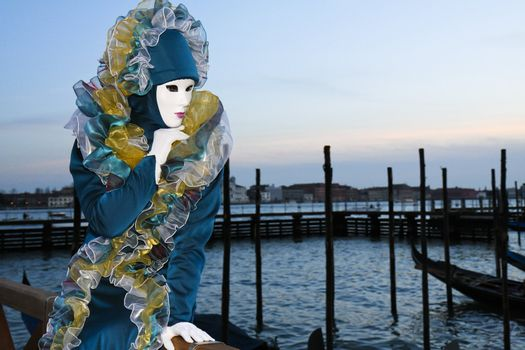 A masked woman in Venice