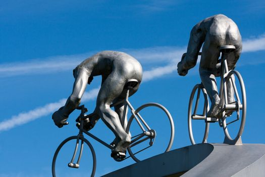 Two cyclists and their muscles