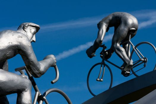 Two cyclists climbing