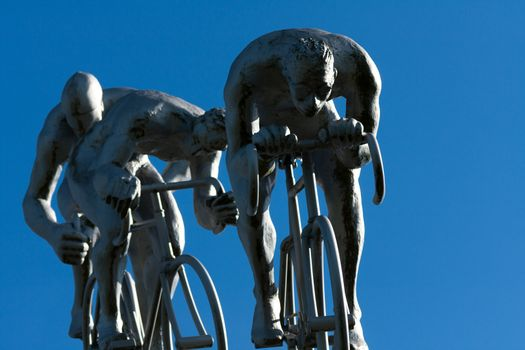 Three cyclists in a slope