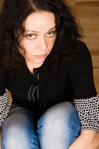 woman sitting on a wooden floor