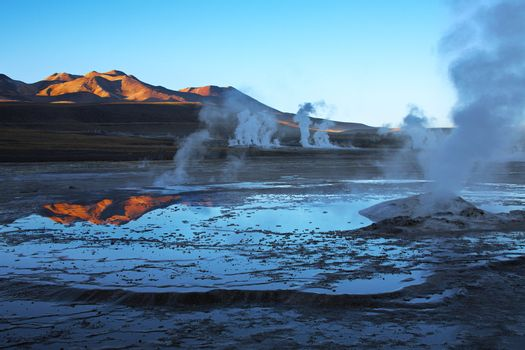 sunrise on geyser field El Tatio in Atacama region, Chile