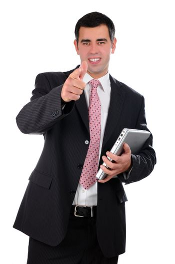 Portrait of a confident young businessman in a dark suit holding laptop isolated on white