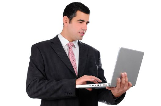 Close up of young businessman holding laptop