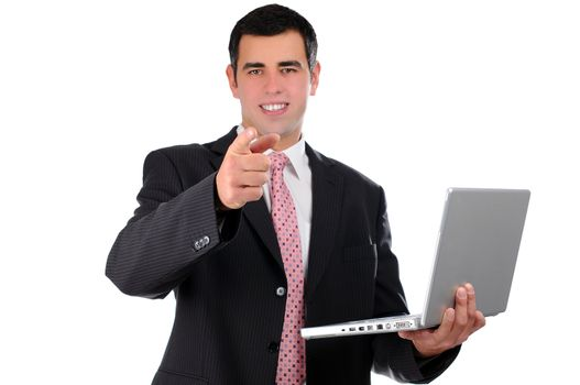 Close up of young businessman holding laptop pointing finger forward