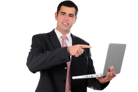 Close up of young businessman holding laptop poining finger on it