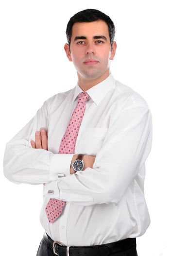 Portrait of a confident young businessman in a white shirt with pink tie isolated on white