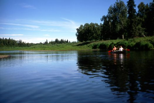 Two persons rowing in the lake in Alaska