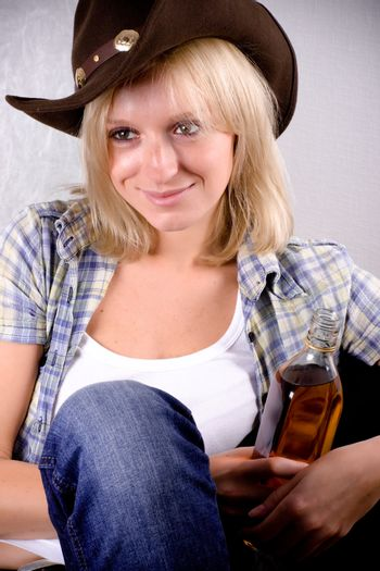 western woman with bottle of whiskey