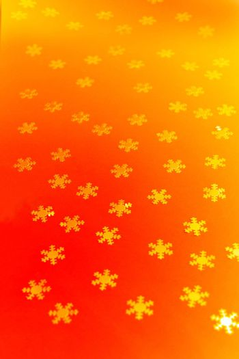a background with lots of snowflake shapes
