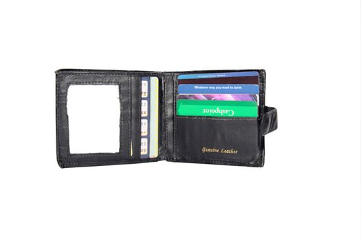 leather wallet with some credit cards (made up fake cards ) with a clipping path