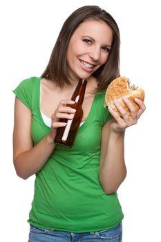 Girl eating burger drinking beer