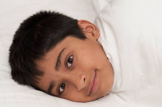 A handsome indian kid smiling for you
