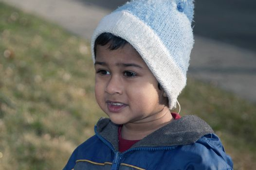 handsome indian kid eager for the spring season