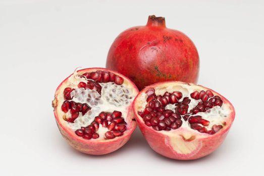 fresh cut pomegranate on a white background
