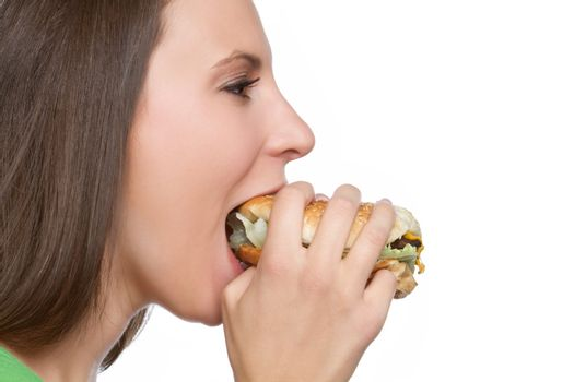 Beautiful girl eating hamburger food