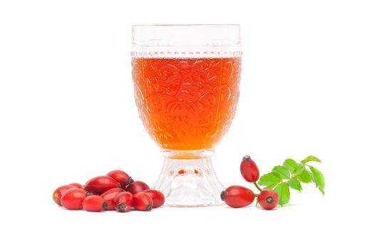 Rosehip wine with berries and leaves on a white background.