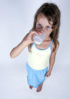 Cute girl with milk