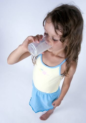 Cute girl with glass of milk