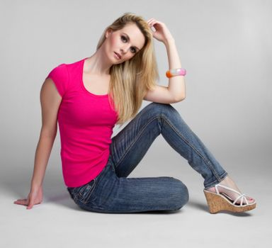 Pretty young blond woman sitting