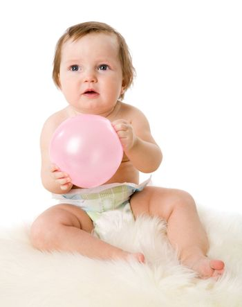 Baby girl in age one year sitting holding balloon isolated