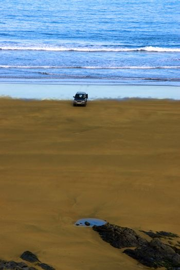 car on beach left unattended
