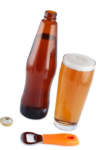 Beer in bottle with bottle opener and glass. Clipping path.