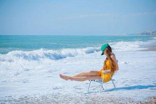 Slim woman in waves