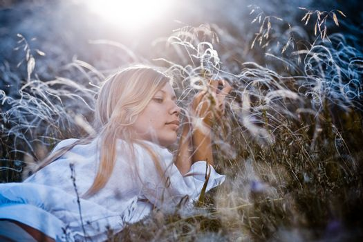 Woman in feather grass