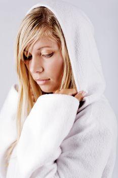 Blond girl wearing white hood