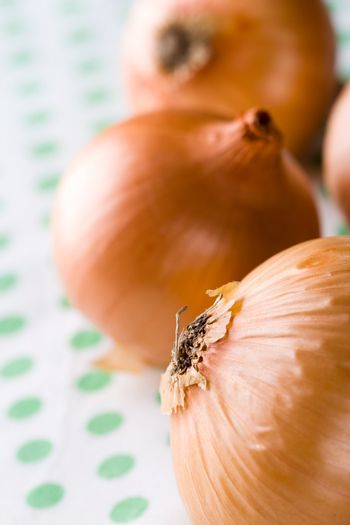 ripe onions on textile background