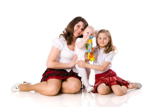 Mother with daughters sitting together isolated on white