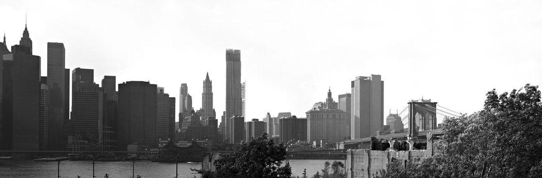 A panoramic image of the New York City Manhattan skyline including the Brooklyn bridge  bridge.