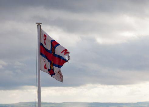RLNI Flag on cloudy day