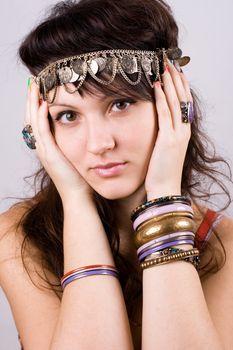 brunette lady with bracelets
