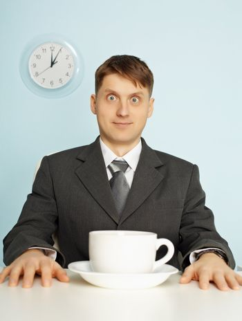 Businessman has drunk coffee and stare wide-eyes