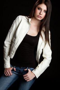 Teenage girl wearing leather jacket
