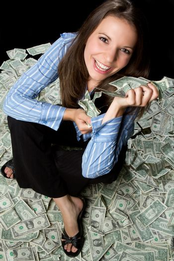 Smiling young woman holding money