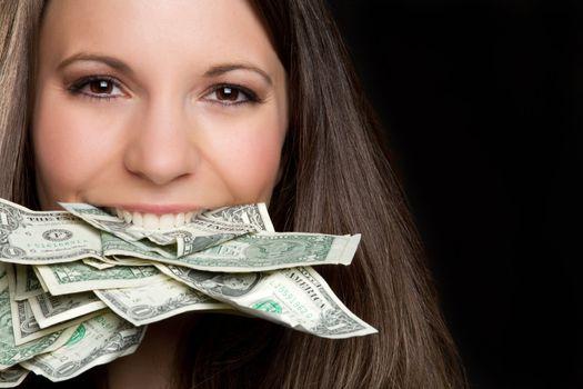 Beautiful woman eating cash money