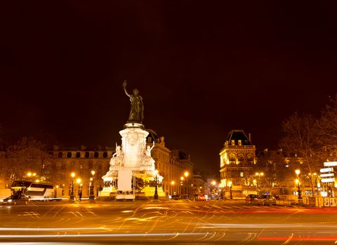 Marianne statue on the Republic square at night in Paris France