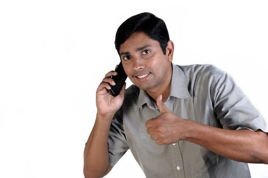 An handsome Indian businessman on call all the time