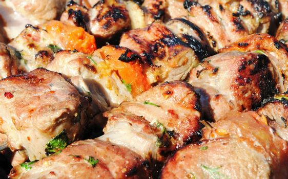 Kebabs, threaded on a skewer and grill