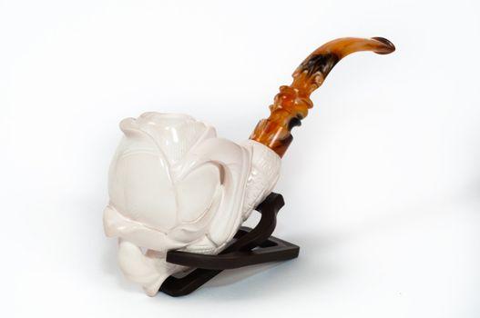 Turkish meerschaum smoking pipe on white screen.