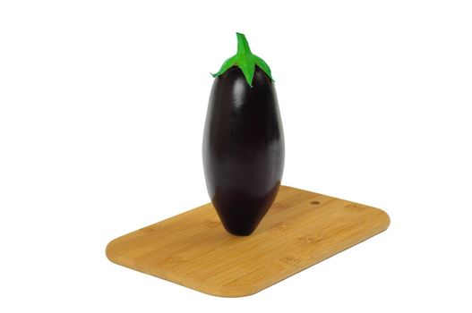 Eggplant on wooden board isolated on white
