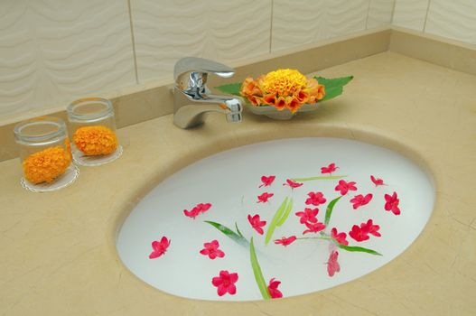 Decoration bathroom in the hotel. Flowers and suds.