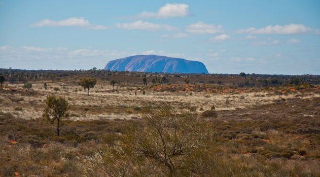 panoramic view of ayers rock, australian red center