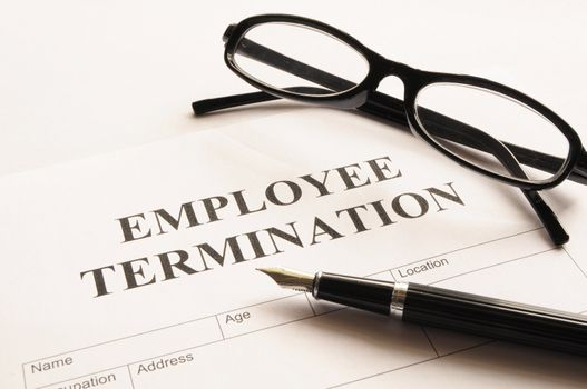 employee termination form on desk in business office showing job concept