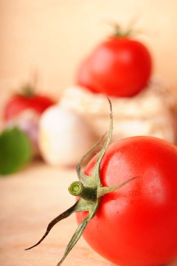tomatoes vegetable and garlic with copyspace showing food concept