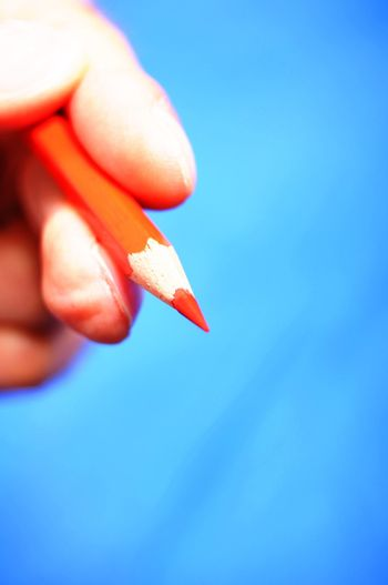 hand pen and blue copyspace for text message