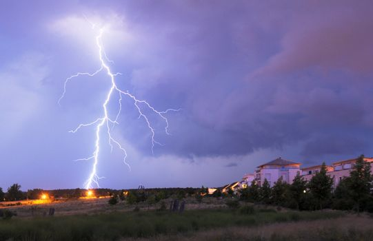 thunderstorm with lightnings and cloudy sky at rainy night